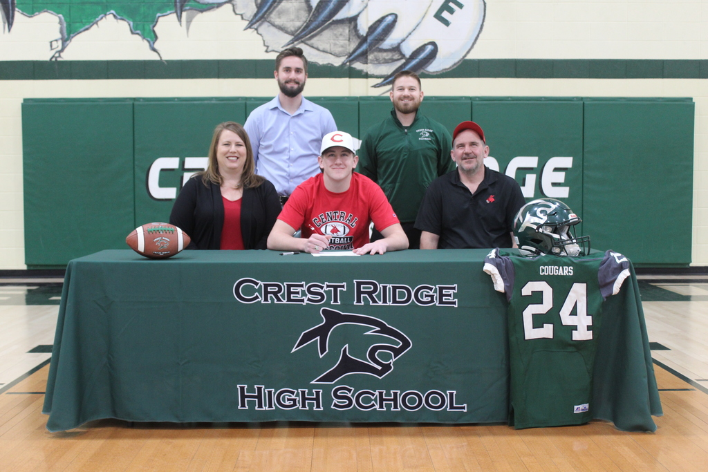 Blayne with his parents and coaches.